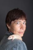 Baby rat sits on the shoulder Stock Images