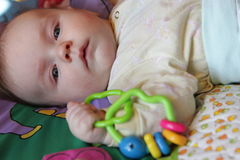 Baby with rattle Royalty Free Stock Photos