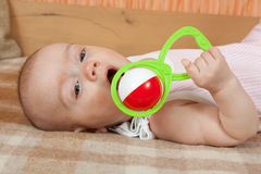 Baby with rattle Royalty Free Stock Image