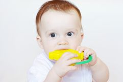 Baby with rattle. Baby age of 8 months with rattle Stock Photo