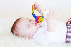 Baby with a rattle Royalty Free Stock Images