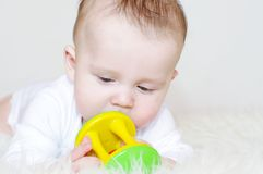 Baby with a rattle Royalty Free Stock Photos