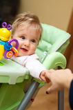 Baby Reaches for Mother. Baby in a stroller reaching out for the hand of her mother Stock Photos