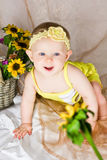 Baby reaching the flower Royalty Free Stock Photography