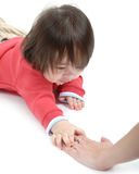 Baby reaching for hand. Baby boy reaching out to touch an adult hand Royalty Free Stock Photos