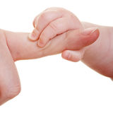 Baby reaching for index finger Royalty Free Stock Photography