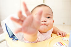 Baby reaching to camera Stock Image