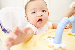 Baby reaching to camera Royalty Free Stock Image