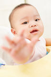 Baby reaching to camera Stock Images