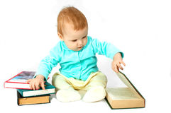 Baby read the book. On white royalty free stock image