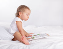 Baby reading book Royalty Free Stock Image