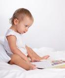 Baby reading book Stock Photos
