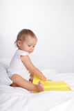 Baby reading book Stock Image