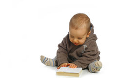 Baby reading book. A small baby reading an interesting book Stock Photography