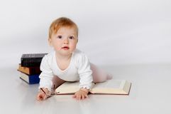 Baby reading book Stock Photos