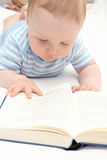 Baby reading a book Stock Photos
