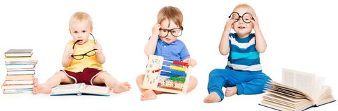 Baby Reading Book, Kids Early Education, Smart Children group. In Glasses, white isolated background Royalty Free Stock Photography