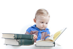 Baby reading books - education concept