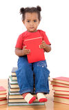 Baby reading sitting on a pile of books. Adorable african baby reading sitting on a pile of books on a over white background royalty free stock images