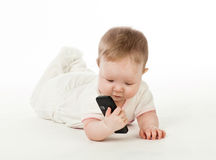 Baby reading sms Stock Photo