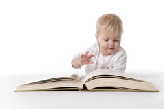Baby reads a large book Royalty Free Stock Photo