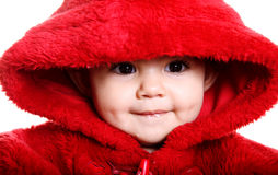 Baby in red. Front view. Beautiful baby with red hood over white background Royalty Free Stock Image