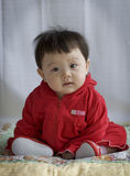 Baby in red Royalty Free Stock Images