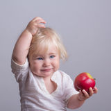Baby a red apple Stock Photos