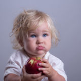 Baby a red apple Royalty Free Stock Photo