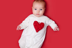 Baby on red background Royalty Free Stock Images