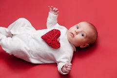 Baby on red background Stock Photography