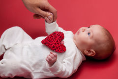 Baby on red background Stock Photo