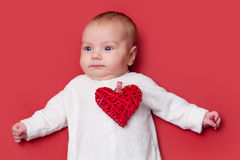 Baby on red background Royalty Free Stock Photo