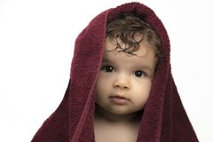 Baby in red bath sheet royalty free stock image