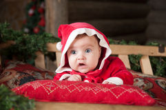 Baby in red clothes, Christmas time Royalty Free Stock Image