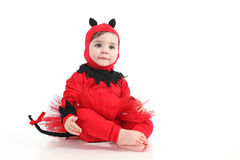 Baby with a red demon disguise Royalty Free Stock Images