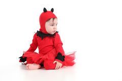 Baby with a red demon disguise Stock Photography