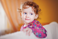 The baby in a red dress Stock Images