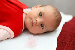Baby in red dress Royalty Free Stock Photo