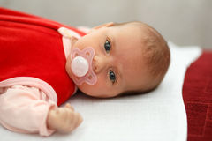 Baby in red dress Stock Images