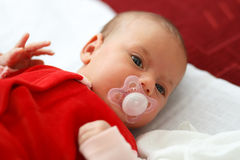 Baby in red dress Royalty Free Stock Photography