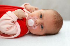 Baby in red dress Royalty Free Stock Images