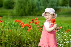 Baby with red flower Stock Image