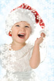 Baby in red hat. With snowflake Stock Photos