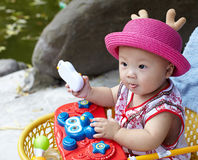 Baby in red hat Stock Images