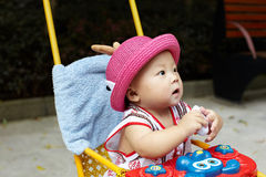 Baby in red hat Stock Photography