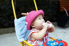 Baby in red hat Stock Photo