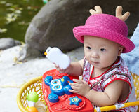 Baby in red hat Stock Image