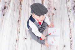 Baby with red kiss. Lovely baby boy in barret with lipstick kiss on his cheek Stock Images