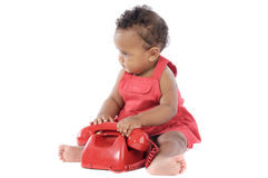 Baby with red phone Royalty Free Stock Photos